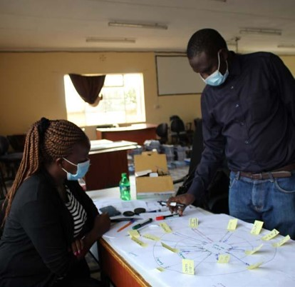 Interview participant describing network interactions in Kitui County. Photo by Angeline Mulwa. 2020