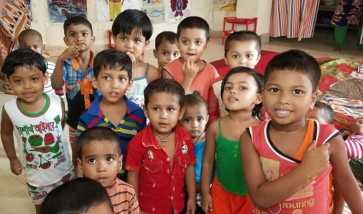 Children being cared for in the daycare of the Serina Garment Factory, Chittagong, Bangladesh/Sarah Swift, USAID.