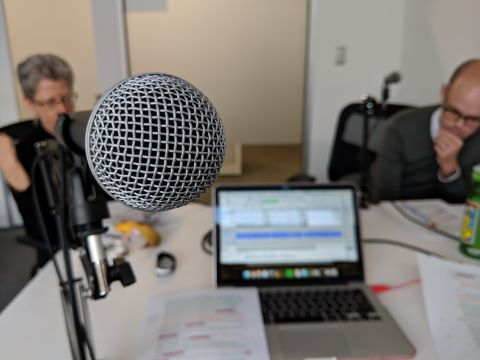 Microphone and laptop in podcast studio
