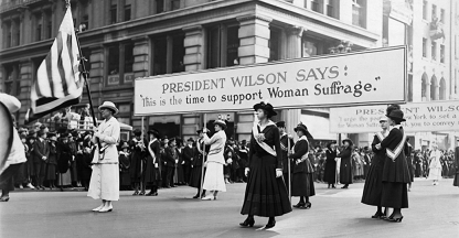 Women, marching for suffrage, use the words of Woodrow Wilson to further their cause. https://www.history.com/topics/us-presidents/woodrow-wilson/pictures/woodrow-wilson/women-suffrage-parade-supporting-wilson