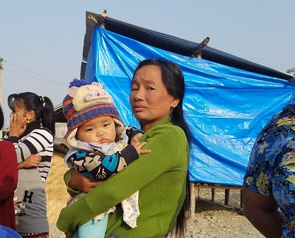 An internally displaced woman and her baby living in a flood-affected community of Itahari, Nepal/ Sarah Swift, USAID
